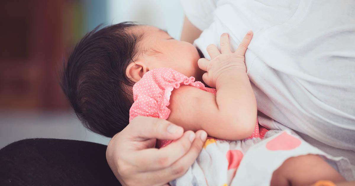 Woman breastfeeding her child