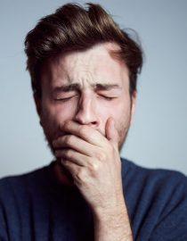 Fatigued man yawning