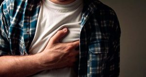 A man is holding his chest