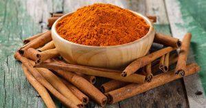 A bowl of cinnamon and cinnamon sticks