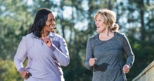Two women are exercising together