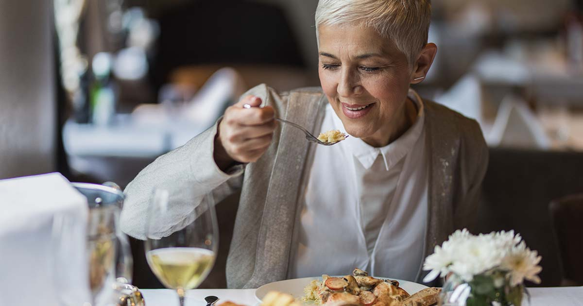 A woman is eating out at a restaurant