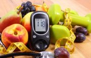 Glucometer, healthy foods, exercise equipment, measuring tape, and a stethoscope