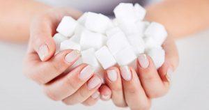 Handfuls of sugar cubes