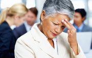 A woman is experiencing a headache