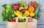 Grocery bag filled with various fruits and vegetables