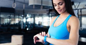 A woman is checking her fitness tracker