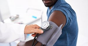 Man's blood pressure is being measured