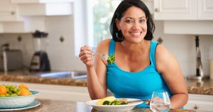 Woman is eating a salad