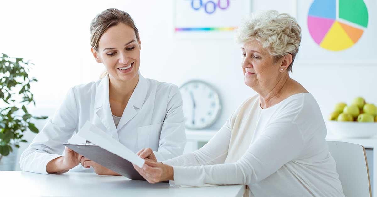 a certified diabetes educator explaining a diet plan to a diabetes patient